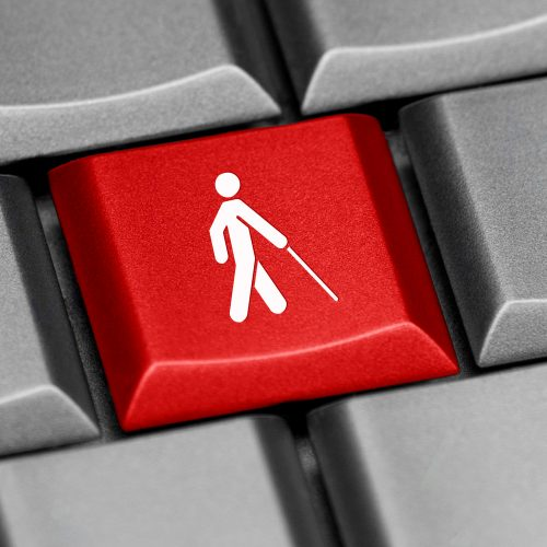 Computer keyboard. Key shows image of person walking with stick.